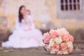 Beautiful bride s bouquet behind the blurred bride soft photo Stock Photos
