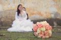Beautiful bride s bouquet behind the blurred bride soft photo Royalty Free Stock Photography
