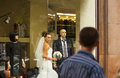 The beautiful bride in showcase is standing between mannequins and looking attractive Stock Images
