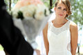 Beautiful bride smile and looking to her groom holding a bouquet Stock Images