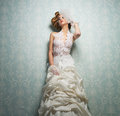 Beautiful Bride Standing Against the Wall Royalty Free Stock Photography