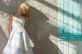Beautiful bride standing near a wall Royalty Free Stock Photo