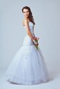 Beautiful bride studio full length portrait holding bouquet toned image Royalty Free Stock Photos