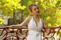 Beautiful bride with stylish make up in white dress Royalty Free Stock Image