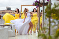 Beautiful Bride and two bridesmaids together on a summer terrace a sea restaurant Royalty Free Stock Photo