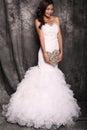 Beautiful bride in wedding dress holding decorative heart Royalty Free Stock Photo