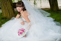 Beautiful bride in wedding dress on nature young Stock Image