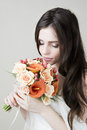 Beautiful bride with wedding orange bouquet studio portrait of a young a professional make up and hair style Royalty Free Stock Photos