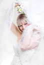 Beautiful bride in a white dress under white veil Royalty Free Stock Photography