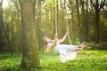 Beautiful bride in white wedding dress smiling and swinging in the forest portrait of a Royalty Free Stock Images