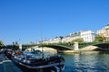 Beautiful bridge of seine river with docking boats paris france Stock Images