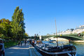 Beautiful bridge of seine river with docking boats paris france Royalty Free Stock Photos
