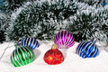 Beautiful, bright Christmas balls in snow. Royalty Free Stock Photos