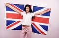 Beautiful British girl smiling holding up the UK flag. Stock Images