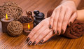 Beautiful brown manicure on a bamboo background Stock Photos