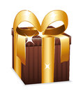 Beautiful brown wrapped gift box with large golden bow Stock Photography