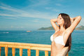 Beautiful brunette basking in the sun travel Royalty Free Stock Photography