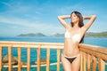 Beautiful brunette basking in the sun travel Stock Photos
