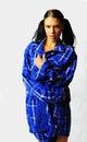 Beautiful brunette in blue flannel Royalty Free Stock Photo