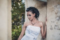 Beautiful brunette bride in white wedding dress photo Stock Photography
