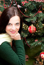 Beautiful brunette by the Christmas tree Royalty Free Stock Image