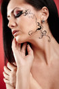 Beautiful brunette with facial tattoo closeup portrait of a Royalty Free Stock Photo