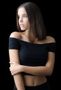 Beautiful brunette girl in black clothes isolated on black Royalty Free Stock Photo