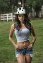 Beautiful brunette girl with country look outdoors shot in sunny summer day rustic style attractive woman with cowboy hat denim Royalty Free Stock Photo