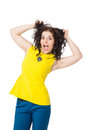 Beautiful brunette girl with curly hair wearing yellow blouse an happy and blue pants over white background Stock Images