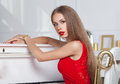 Beautiful brunette girl in a fashionable evening dress red lips studio shot sexy hot Stock Photos