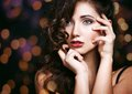 Beautiful brunette girl healthy long hair and holiday makeup Royalty Free Stock Photography