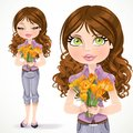 Beautiful brunette girl holding a bouquet of yellow crocuses on white background Royalty Free Stock Photography