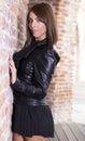 Beautiful brunette girl near a retro brick wall Royalty Free Stock Photos