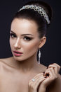 Beautiful brunette girl with perfect skin, evening make-up, wedding hairstyle and accessories. Beauty face. Royalty Free Stock Photo