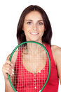 Beautiful brunette girl with tennis racket Royalty Free Stock Photo
