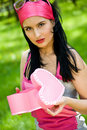 Beautiful brunette with heart shaped jewelry box Stock Photos
