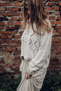 Beautiful brunette hipster woman in white boho sweater and dress Royalty Free Stock Photo