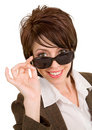 Beautiful Brunette Looking Over Sunglasses Royalty Free Stock Photography