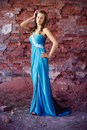 Beautiful brunette in a old building blue evening dress posing fashion photography Stock Photography