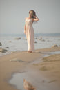 Beautiful brunette in pale pink long dress Royalty Free Stock Photo