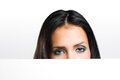 Beautiful brunette peeking out. Stock Photography