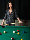 Beautiful brunette playing pool Royalty Free Stock Images