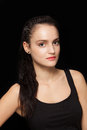 Beautiful brunette with pony tail hair style posing in a studio on black background Royalty Free Stock Images