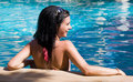 Beautiful brunette in the pool in a good mood Royalty Free Stock Photo