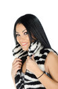 Beautiful brunette posing and showing her furry vest against white background Royalty Free Stock Image