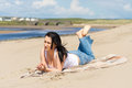 Beautiful brunette relaxing on the beach Royalty Free Stock Photo