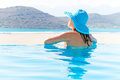 Beautiful brunette relaxing in swimming pool Royalty Free Stock Images