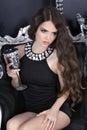 Beautiful brunette sexy girl model in short black dress posing o Royalty Free Stock Photo