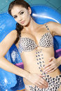 Beautiful brunette in swimmingpool Royalty Free Stock Photography
