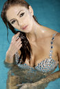 Beautiful brunette in swimmingpool woman with damond make up Stock Photography